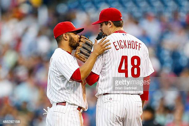Andres Blanco of the Philadelphia Phillies talks with Jerad Eickhoff on the mound after Eickoff gave up two runs in the first inning of the game...