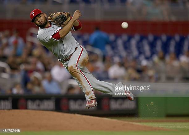 Andres Blanco of the Philadelphia Phillies throws to first base during the game against the Miami Marlins at Marlins Park on August 21 2015 in Miami...