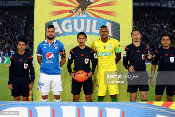 Andres Cadavid captain of Millonarios referee Mario Herrera and Alexis Henriquez captain of Atletico Nacional pose for a photo prior the Semi Finals...