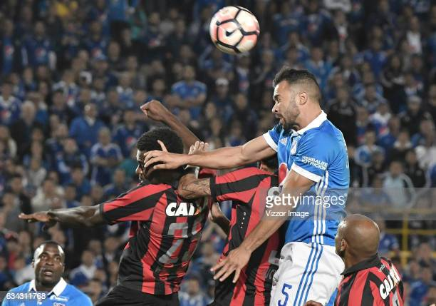 Andres Cadavid of Millonarios fights for the ball with Wanderson of Atletico Paranaense during a match between Millonarios and Atletico Paranaense as...