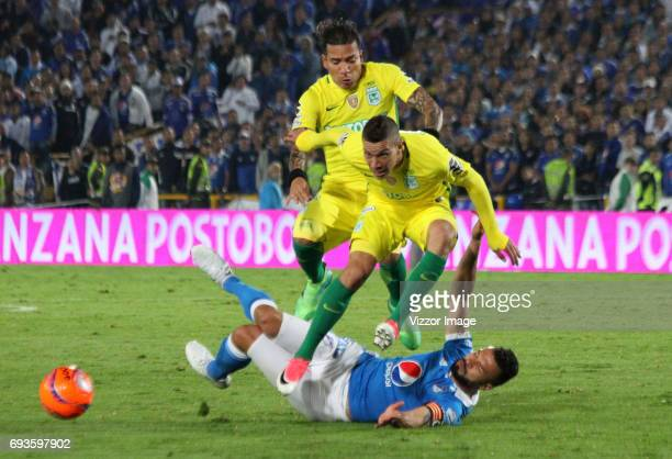 Andres Cadavid of Millonarios fights the ball with Andres Uribe of Atletico Nacional during the Semi Finals first leg match between Millonarios and...