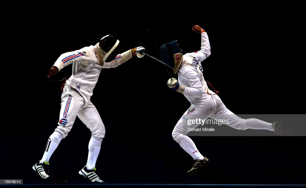 Andres Carrillo of Cuba in action against Ruben Lamardo of Venezula during the Gold Medal Match of the Men's Team Epee, part of the XV Pan American Games on July 20, 2007 at Riocentro Pavilhao in Rio De Janeiro, Brazil.