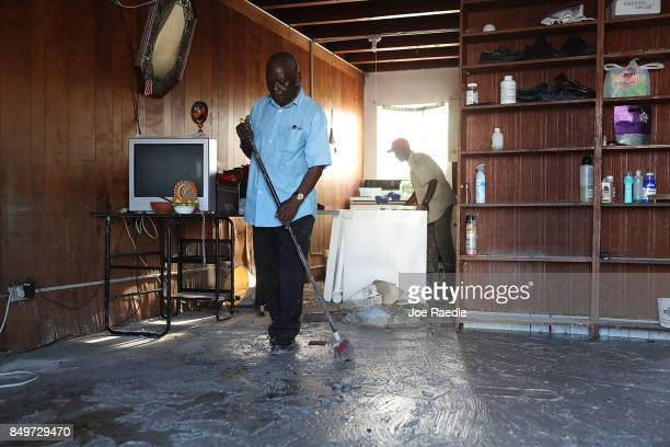 Andres Charles cleans up in his home after it was damaged by hurricane Irma on September 19 2017 in Marathon Florida The process of rebuilding has...