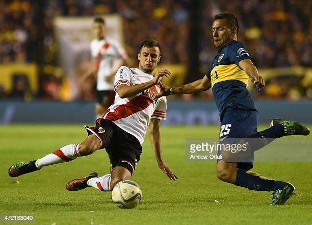 Andres Chavez of Boca Juniors and Emanuel Mammana of River Plate fight for the ball during a match between Boca Juniors and River Plate as part of...