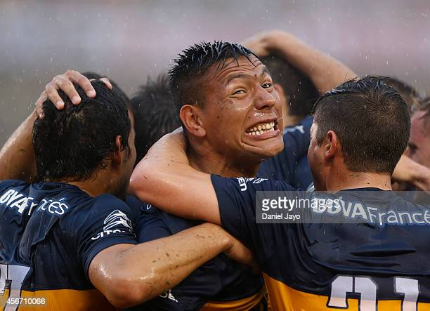 Andres Chavez of Boca Juniors celebrates with his teammates the first goal of his team scored by Lisandro Magallan during a match between River Plate...