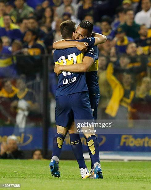 Andres Chavez of Boca Juniors celebrates with Jonathan Calleri after scoring the opening goal during a second leg match between Boca Juniors and...