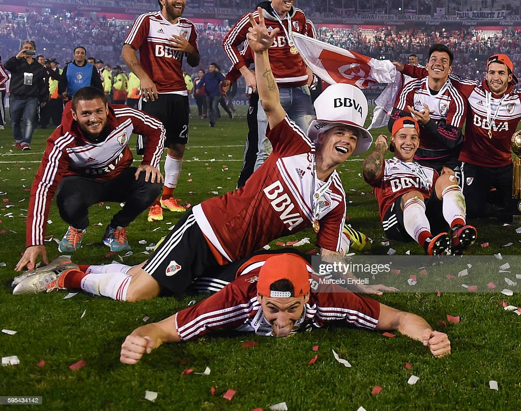 Andres D'Alessandro Lucas Alario and teammates of River Plate celebrate with the trophy after winning the Recopa Sudamericana 2016 during a second...