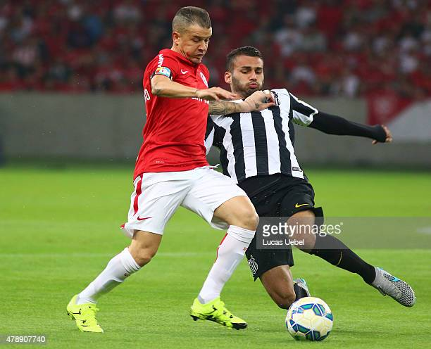 Andres Dalessandro of Internacional battles for the ball against Thiago Maia of Santos during the match between Internacional and Santos as part of...