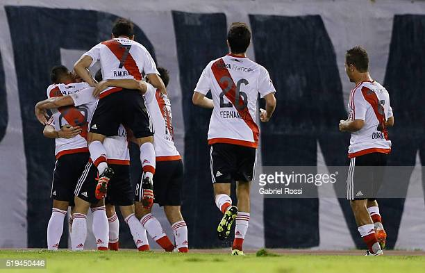 Andres Dalessandro of River Plate celebrates with teammates after scoring the opening goal during a match between River Plate and The Strongest as...