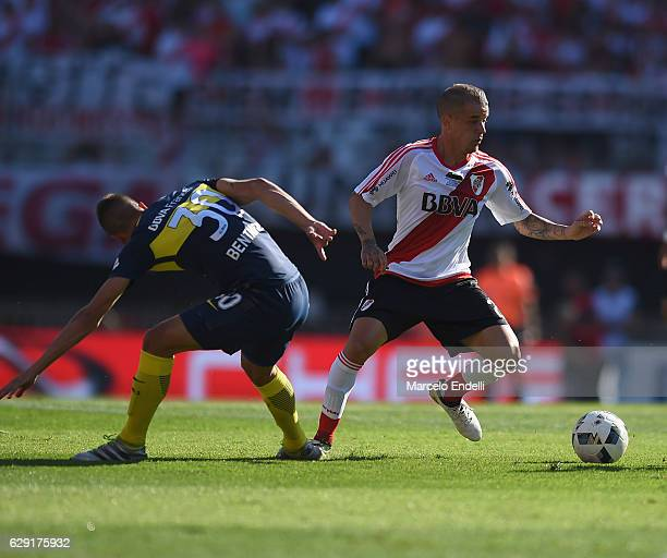 Andres D´alessandro of River Plate fights for the ball with Rodrigo Bentancur of Boca Juniors during a match between River Plate and Boca Juniors as...