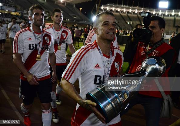 Andres D´alessandro of River Plate holds the trophy after a final match between River Plate and Rosario Central as part of Copa Argentina 2016 at...