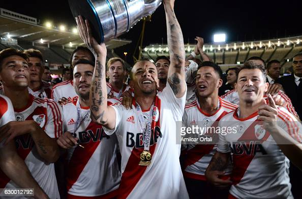 Andres D´alessandro of River Plate lifts the trophy after a final match between River Plate and Rosario Central as part of Copa Argentina 2016 at...