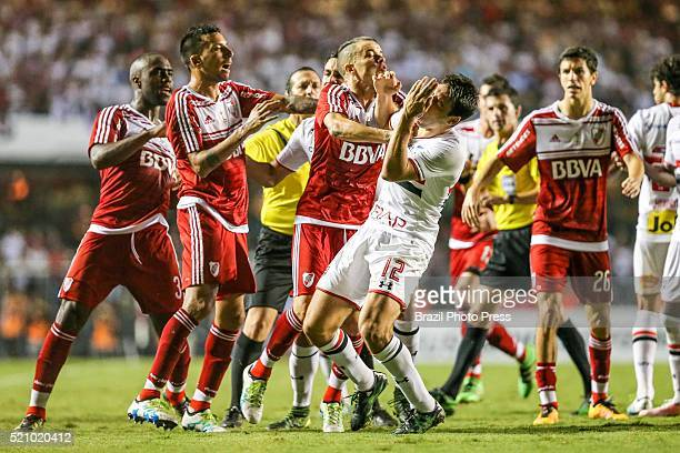 Andres D'Alessandro of River Plate scuffles with Jonathan Calleri Sao Paulo during a match between Sao Paulo and River Plate as part of Copa...