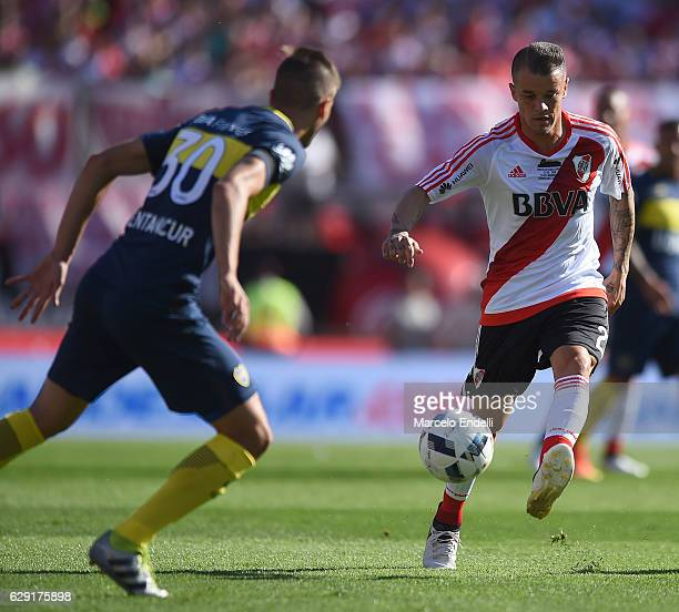 Andres D´alessandro of River Plate vies for the ball with Rodrigo Bentancur of Boca Junios during a match between River Plate and Boca Juniors as...