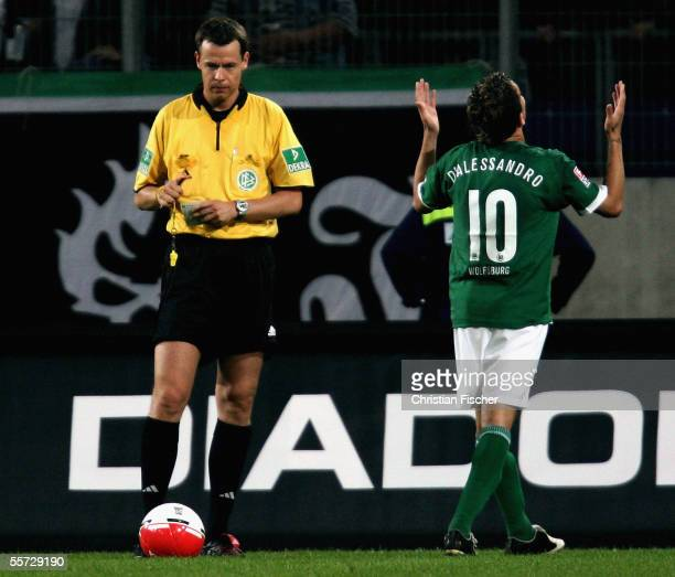 Andres D'Alessandro of Wolfsburg gestures after getting the yellow card from referee Markus Schmidt during the Bundesliga match between Hannover 96...