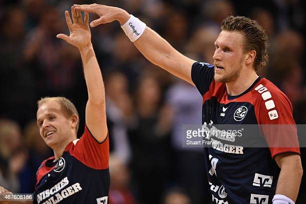 Andres Eggert and Lars Kaufmann of Flensburg celebrate during the DKB Bundesliga handball match between SG FlensburgHandewitt and FA Goeppingen on...