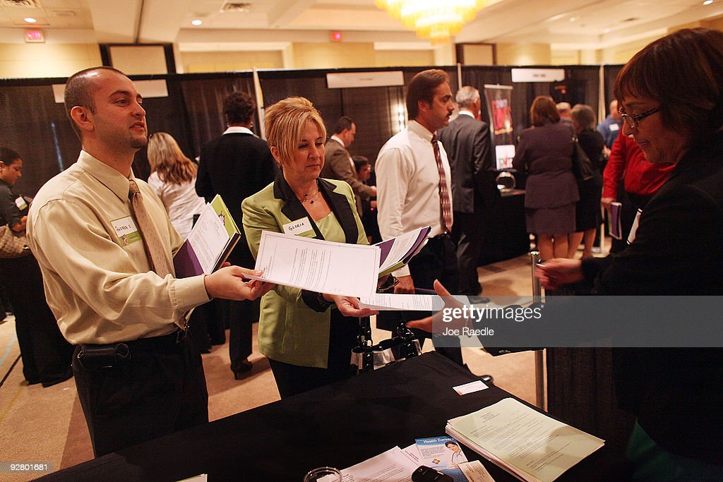 Andres Escobar (L) and Gloria Banegas hand their resumes to Diane-Brito Wigfall as she recruits workers for Talent Tree at a job fair put on by Monster.com on November 5, 2009 in Fort Lauderdale, Florida. The Monster's 'Keep America Working Tour', is helping workers find jobs as the US employment report for October, which comes out tomorrow, is expected to show that the jobless rate stayed close to a 26-year high of 9.8 per cent in September.