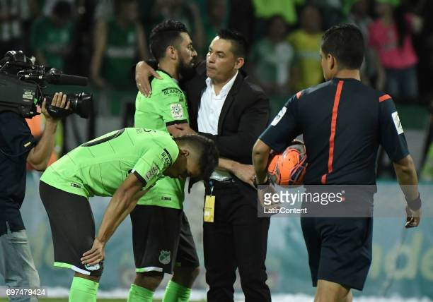 Andres Felipe Roa Andres Perez and coach Hector Cardenas of Deportivo Cali look dejected after the Final second leg match between Atletico Nacional...