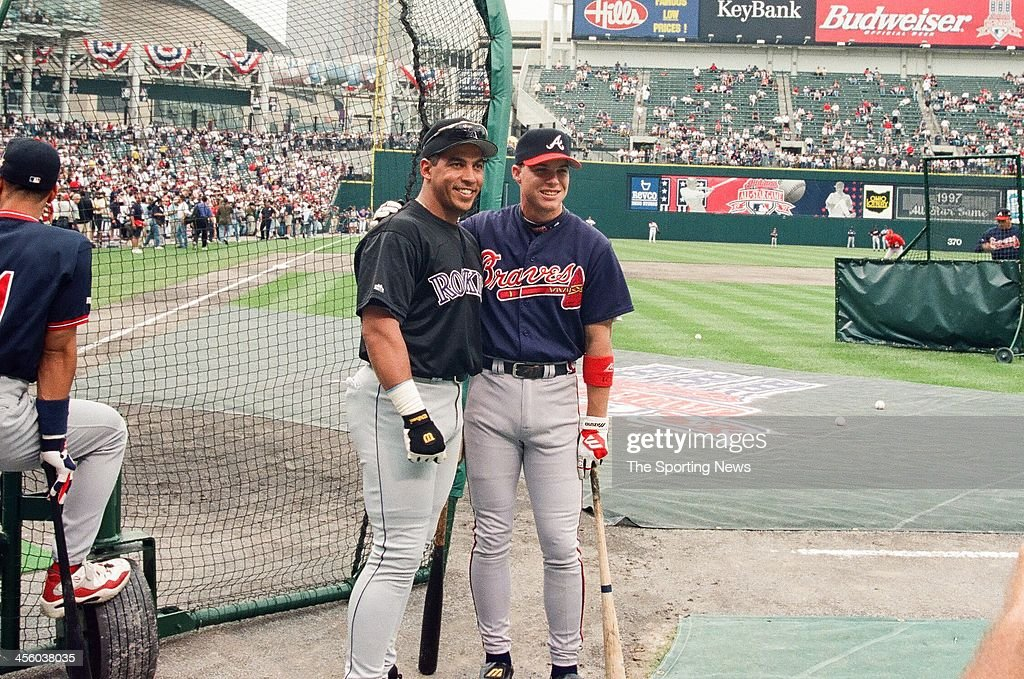 Andres Galarraga of the Colorado Rockies and Chipper Jones of the Atlanta Braves during the 1997 AllStar Game on July 8 1997 at Jacobs Field in...