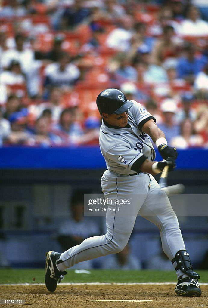 Andres Galarraga of the Colorado Rockies bats against the New York Mets during an Major League Baseball game circa 1996 at Shea Stadium in the Queens...