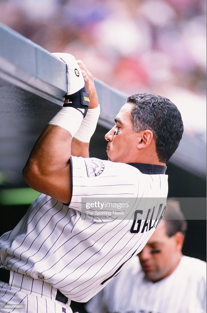 Andres Galarraga of the Colorado Rockies looks on against the Atlanta Braves at Coors Field on September 12 1996 in Denver Colorado The Rockies...