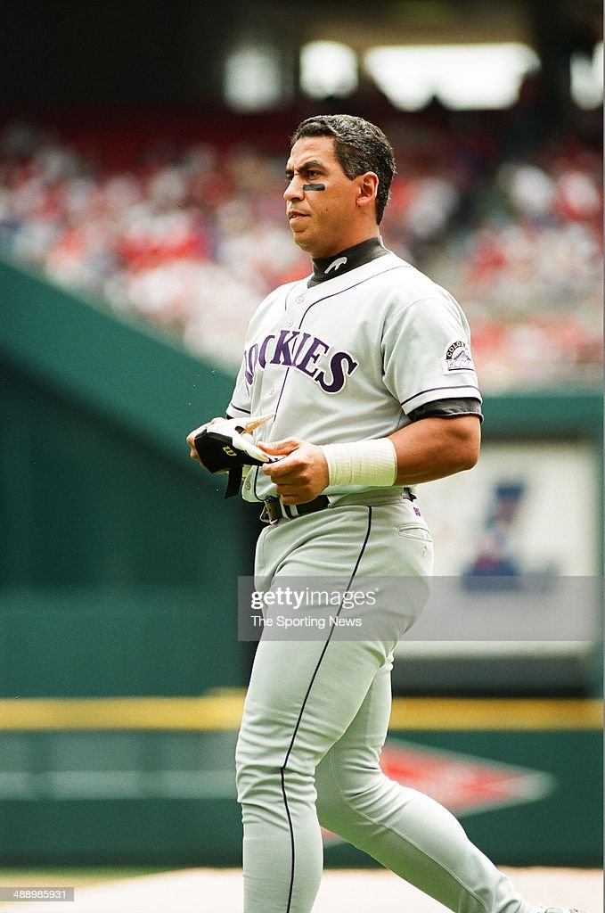 Andres Galarraga of the Colorado Rockies looks on against the St Louis Cardinals at Busch Stadium on April 26 1997 in St Louis Missouri The Rockies...