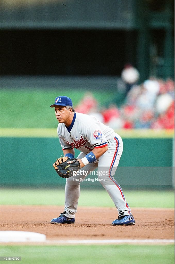 Andres Galarraga of the Montreal Expos fields against the St Louis Cardinals at Busch Stadium on August 8 2002 in St Louis Missouri The Cardinals won...