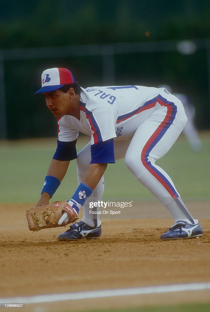 Andres Galarraga of the Montreal Expos is down and ready to make a play on the ball during a spring training Major League Baseball game circa 1989 at...
