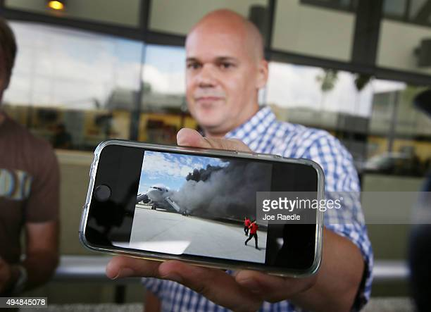 Andres Gallegos who was on the Caracas Venezuelabound Dynamic International Airways Boeing 767 that caught fire shows the media a cell phone picture...