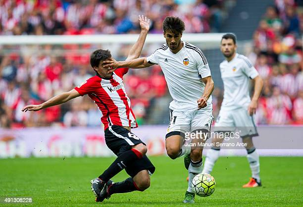 Andres Gomes of Valencia CF duels for the ball with Mikel San Jose of Athletic Club Bilbao during the La Liga match between Athletic Club Bilbao and...