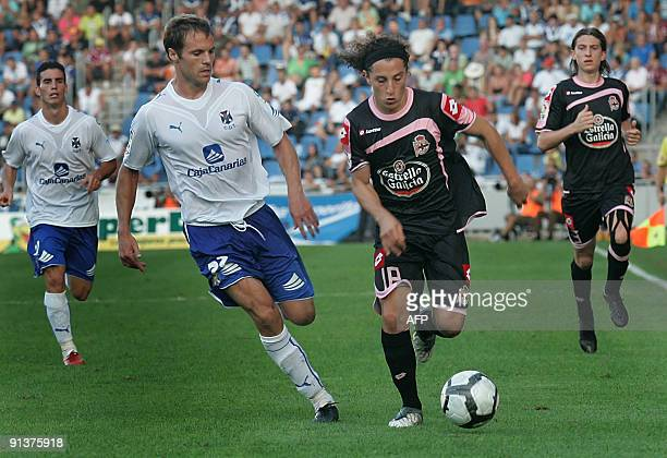 Andres Guaradado Deportivo Coruna's Mexican midfielder vies with Mikel Alonso CD Tenerife's midfierlder during their Spanish first league football...