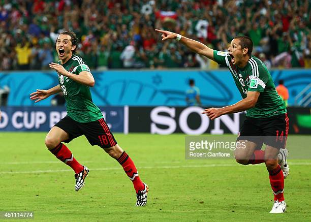 Andres Guardado and Javier Hernandez of Mexico celebrate their team's second goal during the 2014 FIFA World Cup Brazil Group A match between Croatia...