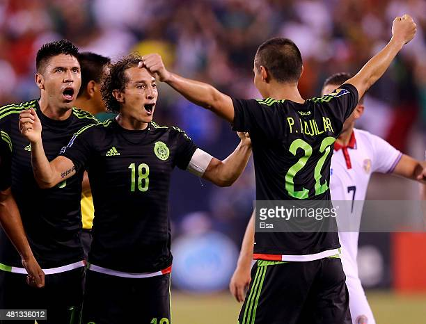 Andres Guardado and Paul Aguilar of Mexico celebrate the win over Costa Rica during the quarterfinals of the 2015 CONCACAF Gold Cup at MetLife...