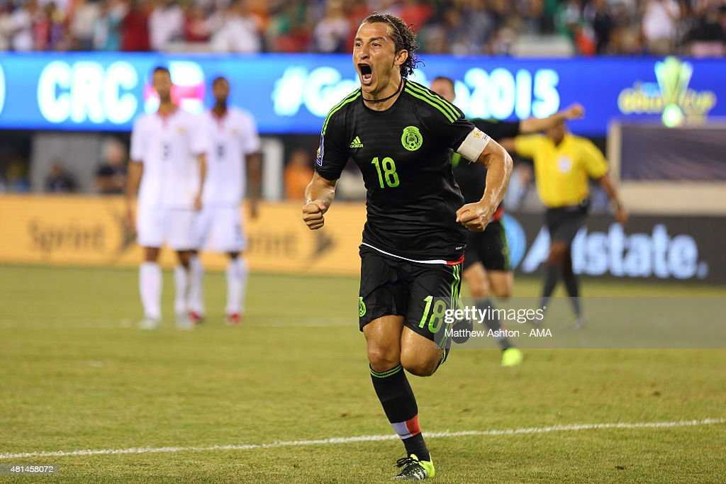 <a gi-track='captionPersonalityLinkClicked' href=/galleries/search?phrase=Andres+Guardado&family=editorial&specificpeople=465479 ng-click='$event.stopPropagation()'>Andres Guardado</a> of Mexico celebrates after scoring a goal to make it 1-0 in the last minute of the game from a controversial penalty kick during the Gold Cup Quarter Final between Mexico and Costa Rica at MetLife Stadium on July 19, 2015 in East Rutherford, New Jersey.