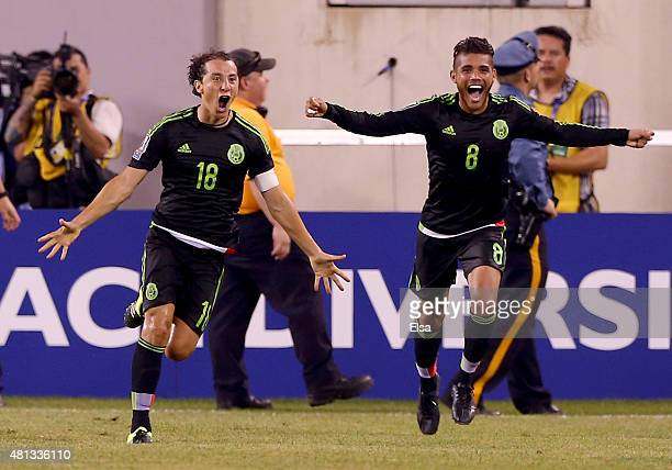 Andres Guardado of Mexico celebrates his goal with teammate Jonathan do Santos in the final minute of overtime against Costa Rica during the...