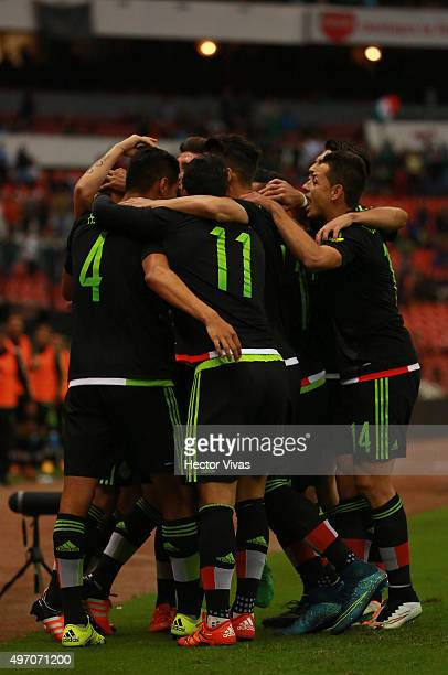 Andres Guardado of Mexico celebrates with teammates after scoring the first goal of his team during the match between Mexico and El Salvador as part...