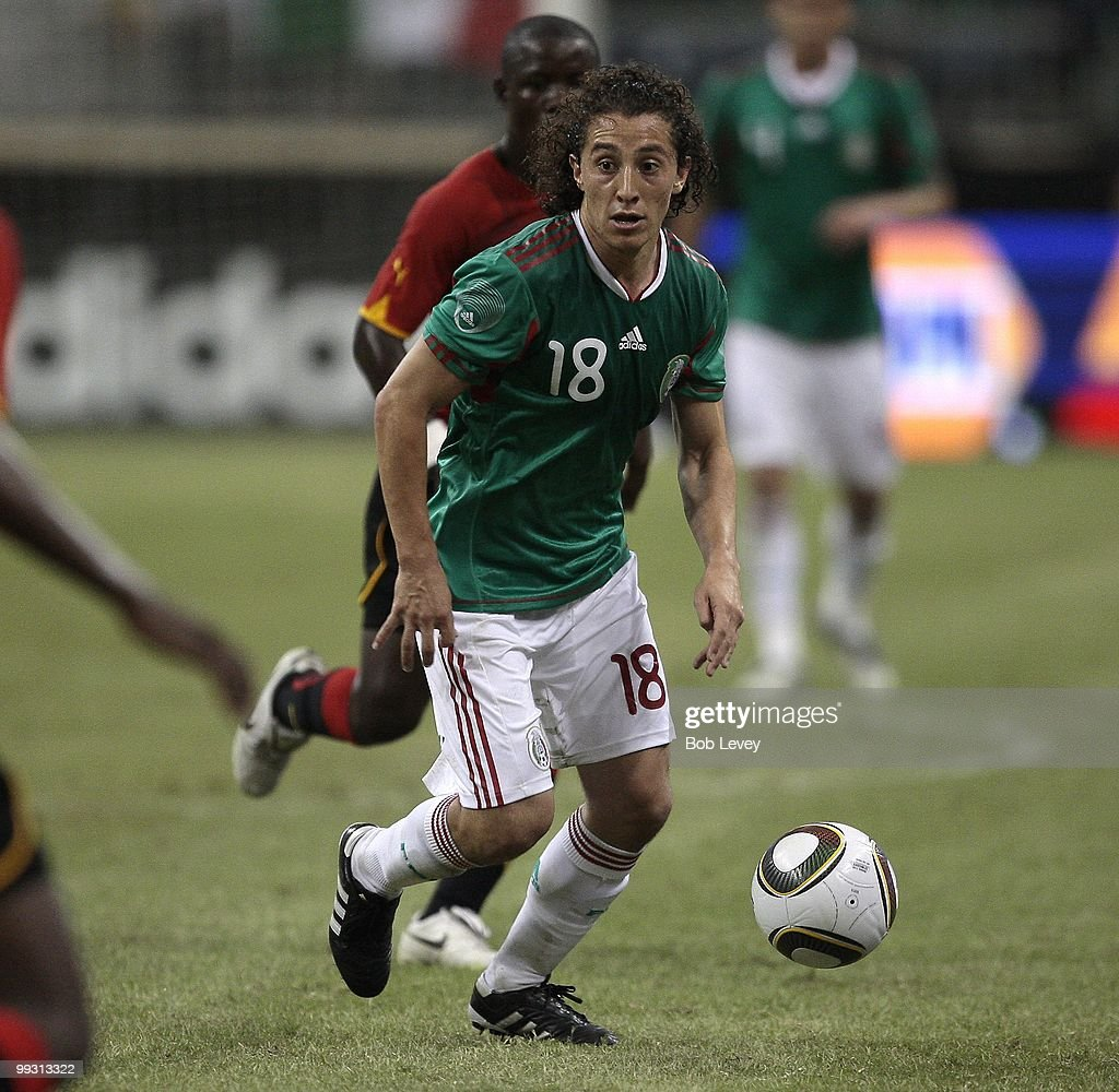 Andres Guardado #18 of Mexico controls the ball against Angola at Reliant Stadium on May 13, 2010 in Houston, Texas.