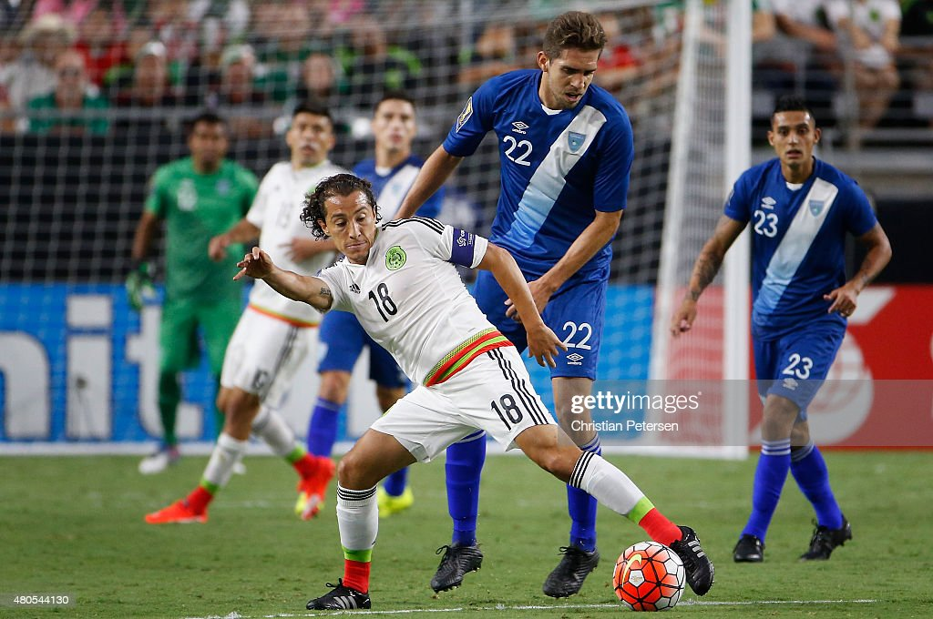 Andres Guardado of Mexico controls the ball under pressure from Minor Lopez of Guatemala during the first half of the 2015 CONCACAF Gold Cup group C...