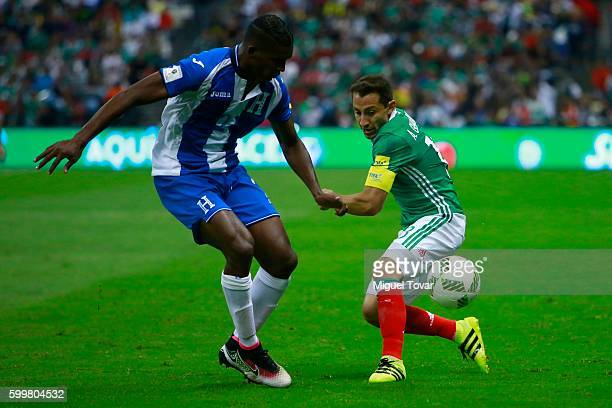 Andres Guardado of Mexico fights for the ball with Brayan Beckeles of Honduras during a match between Mexico and Honduras as part of FIFA 2018 World...