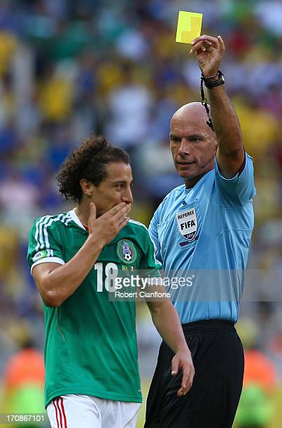 Andres Guardado of Mexico is shown a yellow card by Referee Howard Webb during the FIFA Confederations Cup Brazil 2013 Group A match between Brazil...