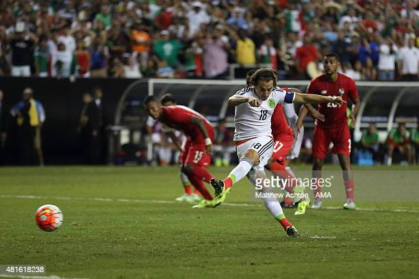 Andres Guardado of Mexico scores a goal to make it 11 from a last minute penalty during 2015 CONCACAF Gold Cup Semi Final between Panama and Mexico...