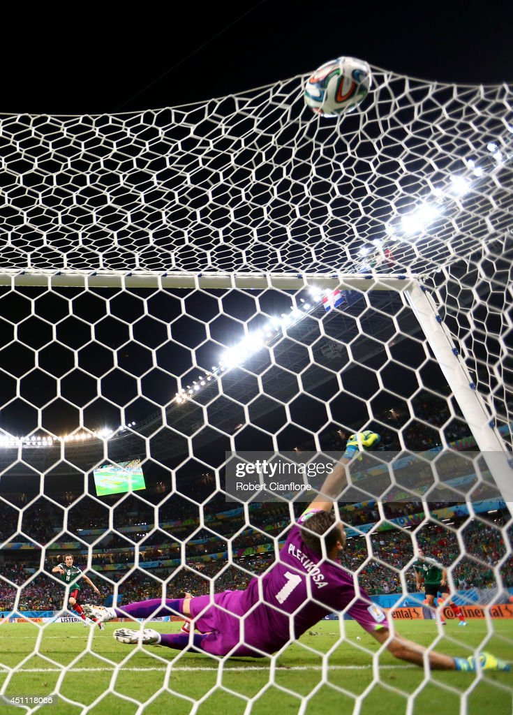 Andres Guardado of Mexico scores his team's second goal past goalkeeper Stipe Pletikosa of Croatia during the 2014 FIFA World Cup Brazil Group A match between Croatia and Mexico at Arena Pernambuco on June 23, 2014 in Recife, Brazil.