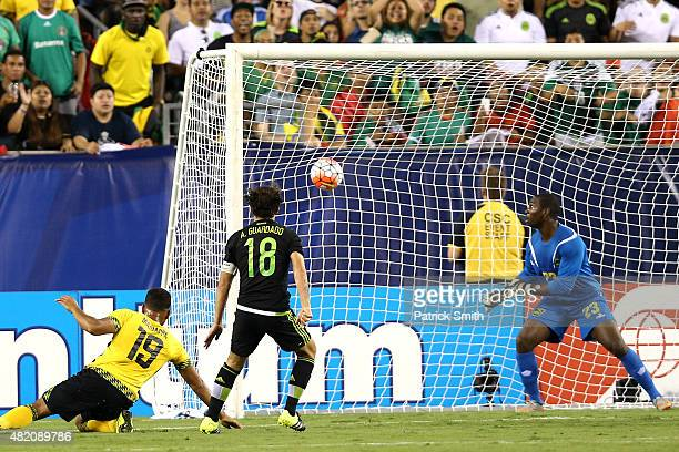 Andres Guardado of Mexico scores on goalkeeper Ryan Thompson of Jamaica in the first half during the CONCACAF Gold Cup Final at Lincoln Financial...