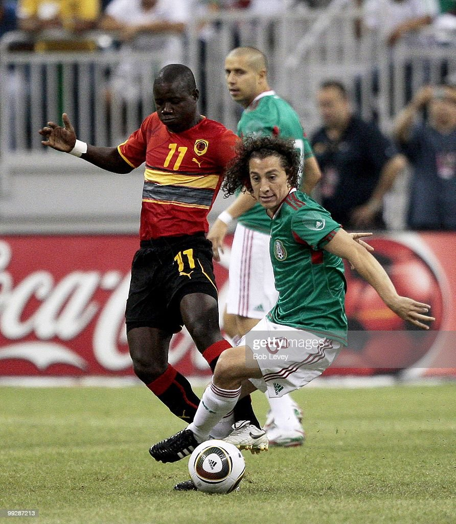 Andres Guardado #18 of Mexico shields the ball from during the friendly international match between Mexico and Angola at Reliant Stadium on May 13, 2010 in Houston, Texas.