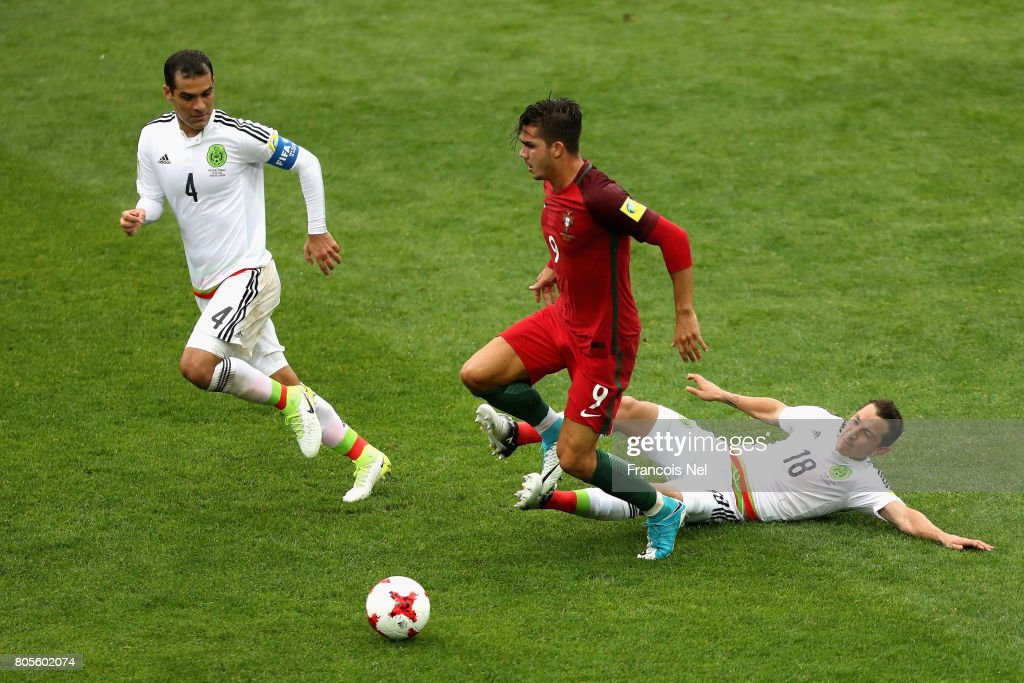 Andres Guardado of Mexico tackles Andre Silva of Portugal during the FIFA Confederations Cup Russia 2017 Play-Off for Third Place between Portugal and Mexico at Spartak Stadium on July 2, 2017 in Moscow, Russia.