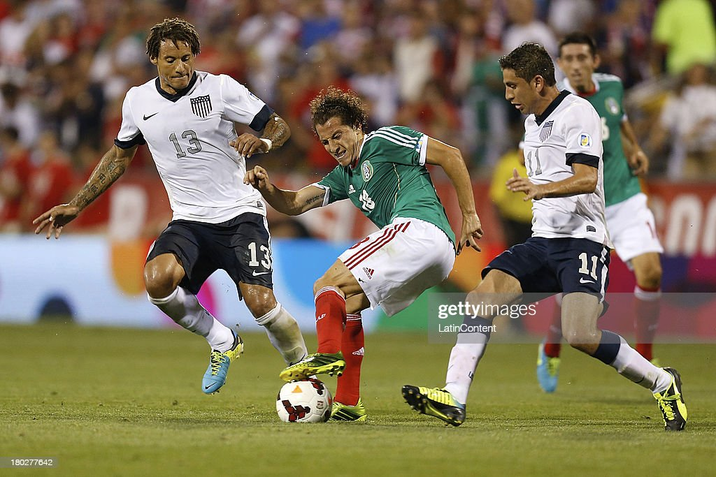 Andres Guardado of Mexico tries to control the ball during a match between United States and Mexico as part of the CONCACAF Qualifiers at Columbus...