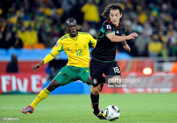 Andres Guardado of Mexico vies for the ball with Reneilwe Letsholonyane of South Africa during the 2010 FIFA World Cup South Africa Group A match...