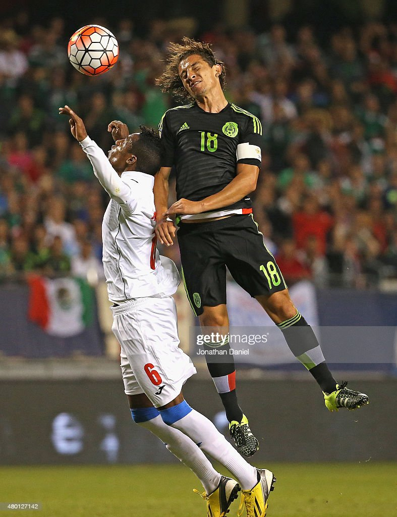 <a gi-track='captionPersonalityLinkClicked' href=/galleries/search?phrase=Andres+Guardado&family=editorial&specificpeople=465479 ng-click='$event.stopPropagation()'>Andres Guardado</a> #18 of Mexicoheads the ball over Yasniel Napoles #6 of Cuba during a match in the 2015 CONCACAF Gold Cup at Soldier Field on July 9, 2015 in Chicago, Illinois.