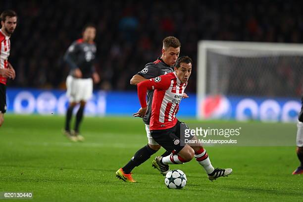 Andres Guardado of PSV Eindhoven is put under pressure from Joshua Kimmich of Bayern Muenchen during the UEFA Champions League Group D match between...
