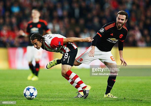 Andres Guardado of PSV Eindhoven is tackled by Juan Mata of Manchester United during the UEFA Champions League Group B match between PSV Eindhoven...